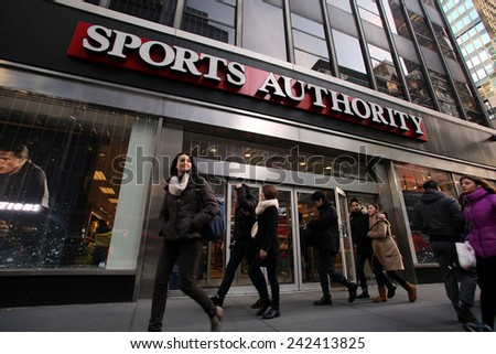 NEW YORK CITY - MONDAY, DEC. 29, 2014: Pedestrians walk past a Sports Authority retail outlet. Sports Authority, Inc. is one of the largest sporting goods retailers in the United States. - stock photo