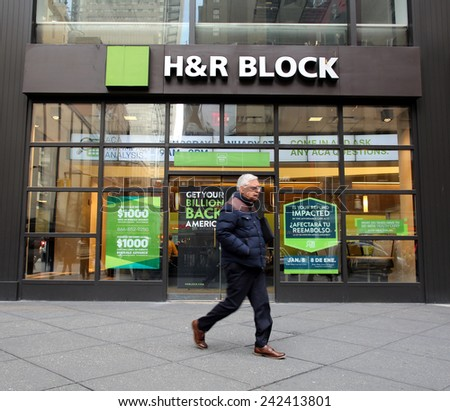 NEW YORK CITY - MONDAY, DEC. 29, 2014: Pedestrians walk past an office of H&R Block. H&R Block is a tax preparation company in the United States - stock photo