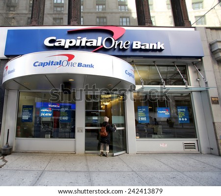 NEW YORK CITY - MONDAY, DEC. 29, 2014: People walk past a Capital One Bank branch.  Capital One Financial Corporation is a U.S.-based bank holding company.