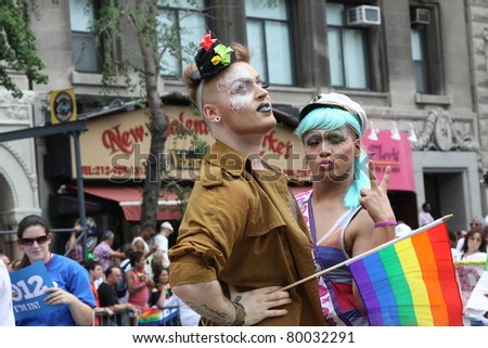 NEW YORK CITY, NEW YORK - JUNE 26: Two unidentified costumed parade participants celebrate during the Gay Rights parade on June 26, 2011 in New York City, New York. - stock photo