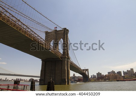 NEW YORK CITY, NEW YORK - MAY 1, 2014: The Brooklyn bridge on May, 1st, 2014 in New York. Completed in 1883, it is one of the oldest bridges of either type in the United States. - stock photo
