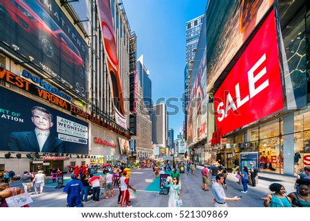 NEW YORK CITY, NEW YORK, USA - JULY 31, 2016: Times square full of people shopping. Sale at H&M store.