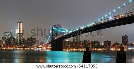 New York City night panorama with Brooklyn bridge and Manhattan skyline. - stock photo