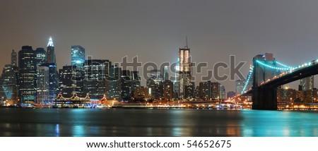 New York City night panorama with Brooklyn Bridge over Hudson River, Manhattan. - stock photo
