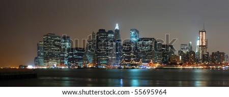 New York City night scene panorama with Manhattan skyline over Hudson River - stock photo