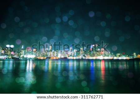 new york city night skyline, with layered double exposure blurry lights - stock photo