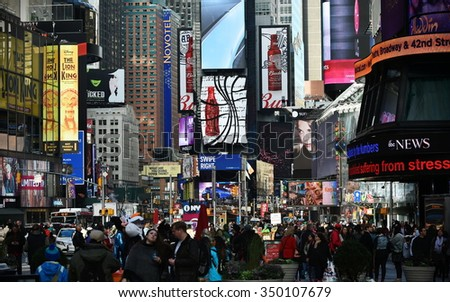 NEW YORK CITY - NOV 11: Crowds of people walk through the landmark Time Square in central Manhattan on Nov 11, 2015 in New York City, USA. - stock photo