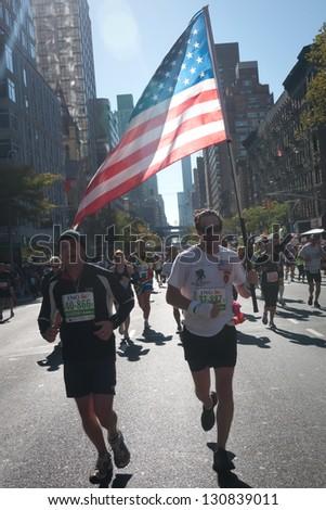 NEW YORK CITY - NOV. 6:  NYC marathon runs the American flag through New York City on Nov. 6, 2011. The NYC marathon was not held in 2012 due to Hurricane Sandy. - stock photo