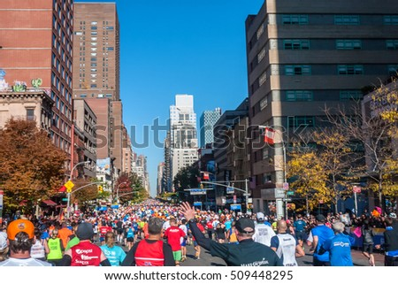 NEW YORK CITY - NOV 11: Thousands of New York City Marathon runners jog 1st Ave. on November 11, 2011. The famous race is one of the world marathon majors and among the most popular.