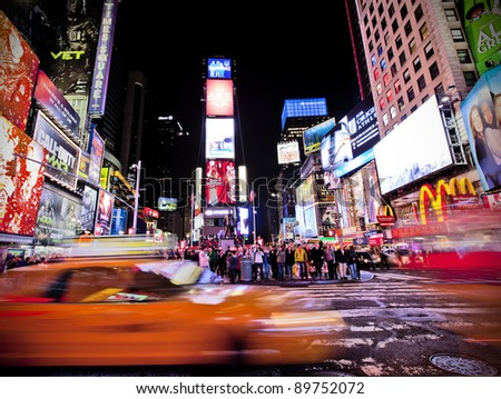 NEW YORK CITY - NOV 13: Times Square ,is a busy tourist intersection of neon art and commerce and is an iconic street of New York City and America, November 13th, 2011 in Manhattan, New York City. - stock photo