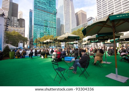NEW YORK CITY - NOV. 3: View of Bryant Park, NYC on Nov. 3, 2011.  Once a potters field it's now a scenic landmark with ice skating, shops, cafes, grounds, carousel, games and respite to visitors. - stock photo
