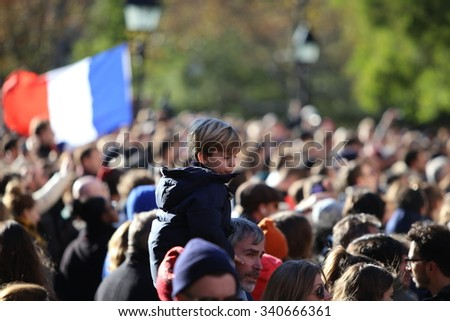 NEW YORK CITY - NOVEMBER 14 2015: A rally at Washington Square Park culminated in a candlelight vigil outside the French consulate for victims of the Paris terror attacks - stock photo