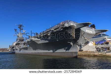 NEW YORK CITY, NOVEMBER 19:  Aircraft carrier USS Intrepid on November 19th, 2014.  The ship is part of the Intrepid Sea, Air & Space Museum and was launched in 1943 serving the US Navy to 1974. - stock photo