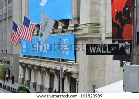NEW YORK CITY - November 7: Banner on the New York Stock Exchange marking Twitters initial public offering on November 7, 2013 in New York City, NY.  - stock photo