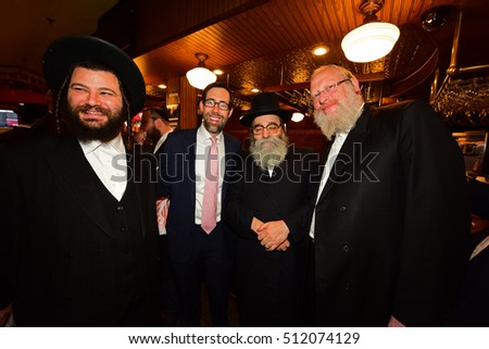 NEW YORK CITY - NOVEMBER 4 2016: Key figures in New York's Democratic Party gathered at Junior's in Brooklyn for Steve Cohn's pre-election breakfast. Daniel Squadron with Hasidic members