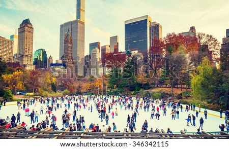 NEW YORK CITY - NOVEMBER 26: Many people ice skating on Central Park in Manhattan, New York City on November 26, 2015, Thanksgiving Day, celebrating holidays, having fun. Instagram filtered look.