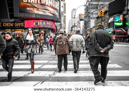 NEW YORK CITY - NOVEMBER 16, 2014:  New York City pedestrians cross busy street in Times Square in midtown Manhattan - stock photo