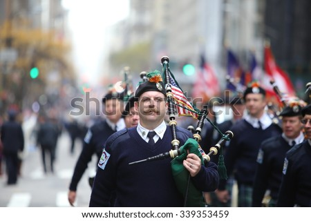 NEW YORK CITY - NOVEMBER 11 2015: New York City's Veterans Day was led by the US navy & grand marshal & world war two naval veteran Robert Morgenthau.  - stock photo