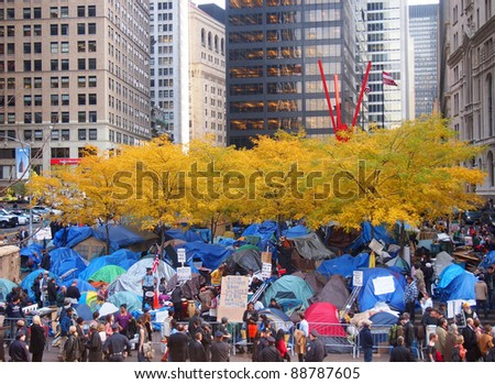 NEW YORK CITY - NOVEMBER 14: Occupy Wall Street protesters live in a tent city as autumn approaches, November 14, 2011 in New York City, NY. The protest against the financial system began September 17, 2011. - stock photo