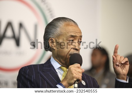 NEW YORK CITY - NOVEMBER 22 2014: Rev Al Sharpton held a rally at National Action Network headquarters to protest the shooting death of Akai Gurley by NYPD officers. Rev Sharpton makes a point - stock photo