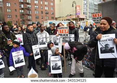 NEW YORK CITY - NOVEMBER 22 2015: Stop Mass Incarcerations Network sponsored a children's march on the anniversary of Tamir Rice's death by police. - stock photo