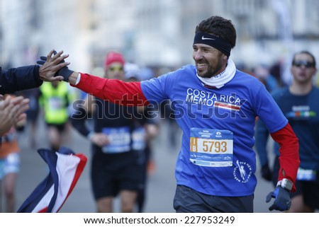 NEW YORK CITY - NOVEMBER 2 2014: the 43rd annual New York City Marathon saw more than 50,000 entrants run through all five boroughs. Male runner gets high five from spectator along 59th Street