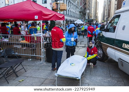 NEW YORK CITY - NOVEMBER 2 2014: the 43rd annual NYC Marathon saw more than 50,000 entrants race through all five boroughs. First aid station on 59th Street near finish line