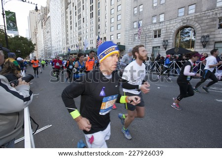 NEW YORK CITY - NOVEMBER 2 2014: the 43rd annual NYC Marathon saw more than 50,000 entrants race through all five boroughs. Runners fill 59th Street