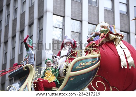 NEW YORK CITY - NOVEMBER 27 2014: the 88th annual Macy's Thanksgiving Day parade stretched from Manhattan's Upper West Side to Herald Square, viewed by 350,000 spectators. Santa Claus in sleigh - stock photo