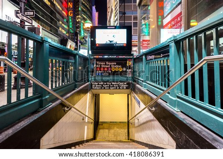NEW YORK CITY - NOVEMBER 5: Times Square, 42 St Subway Station entrance in Manhattan on November 5, 2014. Owned by the NYC Transit Authority, the subway system has 469 stations in operation. - stock photo