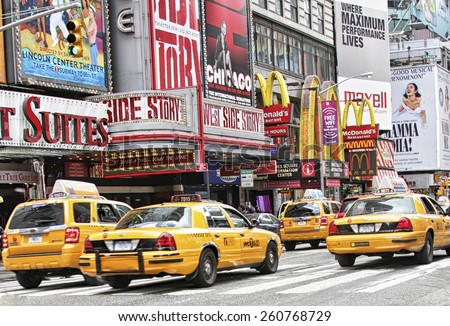 NEW YORK CITY, NY - APRIL 18, 2010: Times Square, famous tourist attraction featured with Broadway Theaters and famous restaurant and store locations in New York City - stock photo