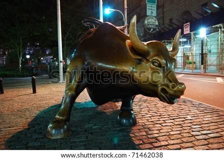 NEW YORK CITY, NY - AUG 7: Wall Street Charging Bull is the symbol of aggressive financial optimism and prosperity and the famous landmark of Wall Street. August 7, 2010 in Manhattan, New York City.