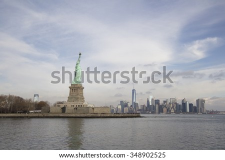 NEW YORK CITY, NY - CIRCA 2015: Liberty Island with Lady Liberty holding torch proudly in the United States of America, an iconic symbol of freedom. - stock photo