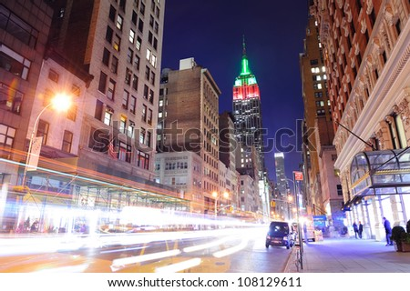 NEW YORK CITY, NY - DEC 30: Empire State Building and street on December 30, 2011 in New York City. It is a 102-story landmark and was world's tallest building for more than 40 years. - stock photo