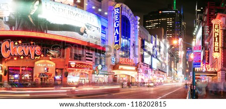 NEW YORK CITY, NY - DEC 12: 42nd Street with traffic and commercials on December  12, 2011 in New York City. 42nd Street is a major crosstown street known for its theaters and landmark architectures. - stock photo
