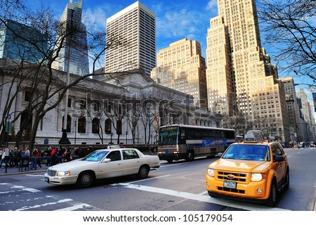 NEW YORK CITY, NY - DEC 30: New York City Public Library skyscrapers and blue sky on December 30, 2011 New York City. It is the 2nd largest in US and managed with both private and public financing.