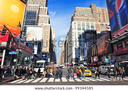 NEW YORK CITY, NY - DEC 30: Pedestrians and street on Fashion Avenue on December 30, 2011 New York City. It is named due to center of the fashion industry establishing NYC as a world fashion capital. - stock photo