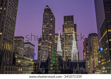 NEW YORK CITY, NY - FEB 12: Construction at St Patrick's Cathedral on February 12, 2015 in New York City. Fifth Avenue has the world's most expensive retail spaces as the symbol of wealthy New York. - stock photo