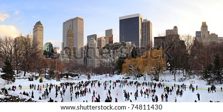 NEW YORK CITY, NY - JAN 1: People skate on ice with white Christmas in Central Park to welcome the new year of 2010 on January 1, 2011 in Manhattan, New York City. - stock photo