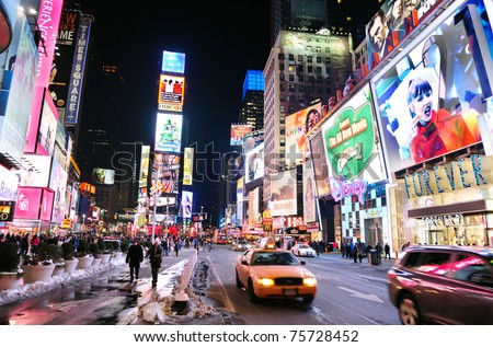 NEW YORK CITY, NY - JAN 30: Times Square is featured with Broadway Theaters and LED signs as a symbol of New York City and the United States. January 30, 2011 in Manhattan, New York City. - stock photo