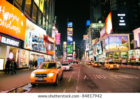 NEW YORK CITY, NY - JAN 30: Yellow Taxi at Times Square on January 30, 2011 in Manhattan, New York City. Times Square is featured with Broadway Theaters and LED signs as a symbol of New York City. - stock photo