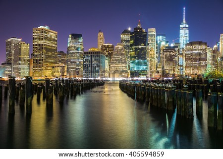 NEW YORK CITY, NY - JANUARY 4, 2016 - A scenic night view of the skyscrapers of New York City from the Brooklyn Bridge Park. - stock photo