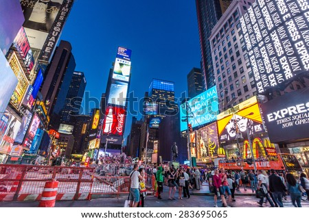 NEW YORK CITY, NY - JUN 24: Times Square and Broadway Theaters at night is one of  the most tourist visited location in New York City on June 24, 2014.