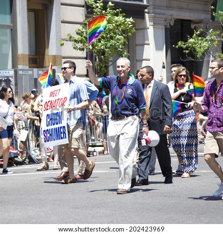 New York City, NY - June 29th, 2014: LGBT Pride Parade in New York City, NY on June 29th, 2014. LGBT pride march takes place during pride week. Senator Chuck Schumer was a guest.