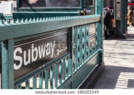 NEW YORK CITY, NY - MARCH 14, 2014:  street view entrance to one of the 468 subway stations operated by the MTA in New York City - stock photo