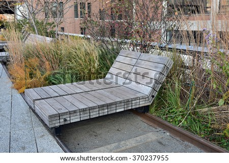 New York City, NY - NOV: The High Line Park in the Chelsea district of New York City on November 15, 2015 is a destination for friends and families to enjoy the outdoors.  - stock photo