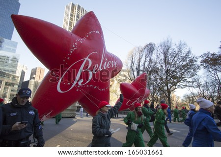 NEW YORK CITY, NY - NOVEMBER 28: Believe Star, final balloon in parade, flying through W 59th ST during the Macy's 87th Annual Thanksgiving Day Parade on November 28, 2013 in New York City, New York.  - stock photo