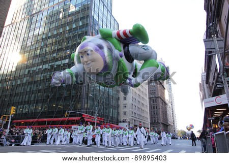 NEW YORK CITY, NY - NOVEMBER 24: Buzz Lightyear balloon flying through air with jetpack in the Macy's 85th Annual Thanksgiving Day Parade on November 24, 2011 in New York City, New York. - stock photo