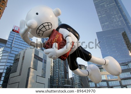 NEW YORK CITY, NY - NOVEMBER 24: Diary of a Wimpy Kid Balloon in front of skyscrapers during the Macy's 85th Annual Thanksgiving Day Parade on November 24, 2011 in New York City, New York. - stock photo