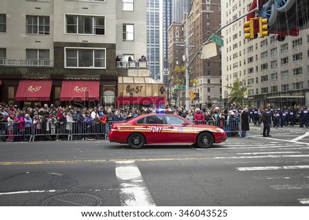 NEW YORK CITY, NY - NOVEMBER 26: Fire Department of NY city standing on 6th Avenue and 57th Street during the 89th Annual Macy's Thanksgiving Day Parade on November 26, 2015 in New York City.  - stock photo